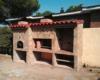 Modulo de horno y barbacoa a medida con acabado en piedra